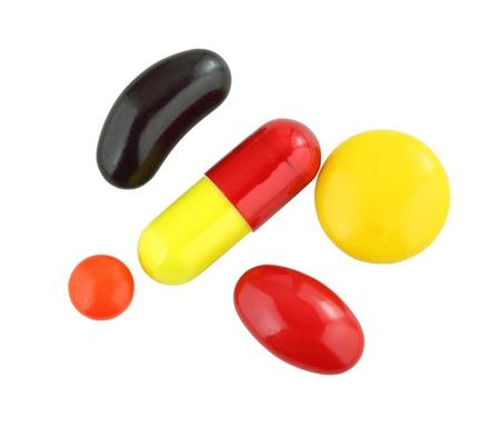 pilule: Surtido de pastillas en el fondo blanco
