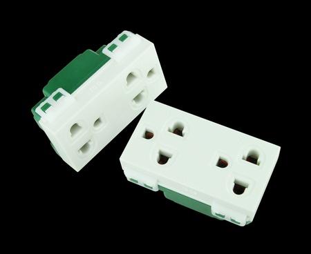 Electrical outlet (socket plug) on black background Stock Photo - 20446244