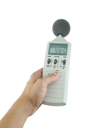 sonido: sonómetro que sostiene en la mano Foto de archivo