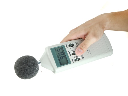 sound level meter holding on hand photo