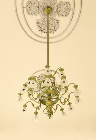 vintagel: beautiful vintagel chandelier hanging under a ceiling Stock Photo