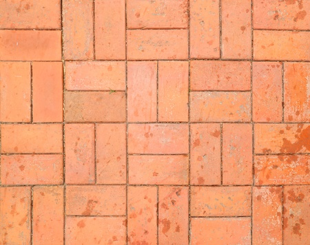 old red brick paving stones on a sidewalk photo