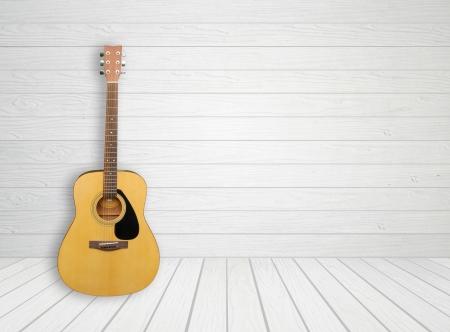 Guitar in blank empty white wood room background Archivio Fotografico