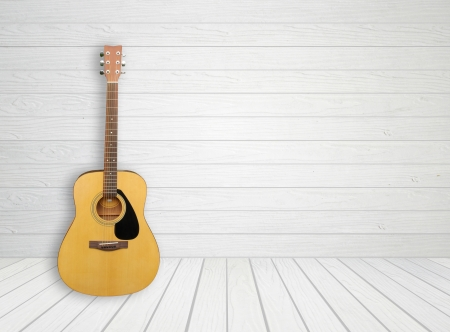 Guitar in blank empty white wood room background photo
