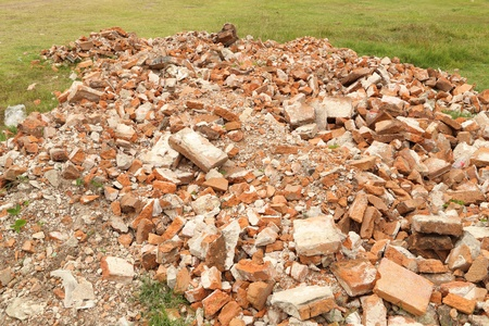 Pile of demolished brick wall photo