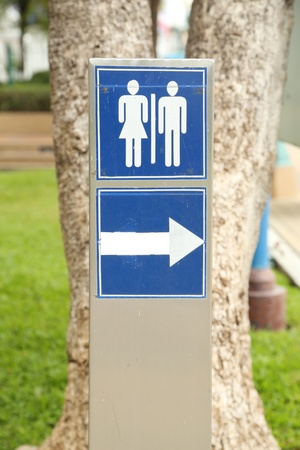 toilet sign with arrow in the park photo