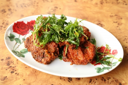 plate of Deep-fried curried fish patties photo