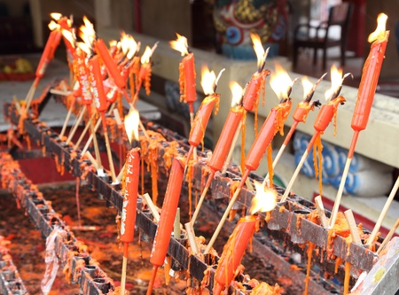lucky red chinese candles in temple photo