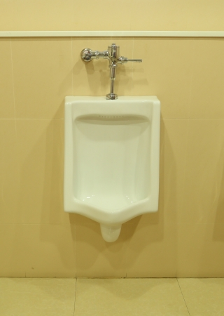 white urinal in the public restroom photo