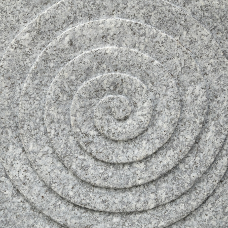 circle spiral stone texture background photo
