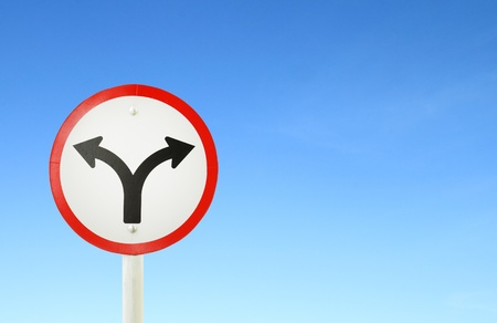 fork junction traffic sign with blue sky blank for text