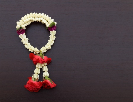 malai: Garland of jasmine flower on wood background blank for text Stock Photo