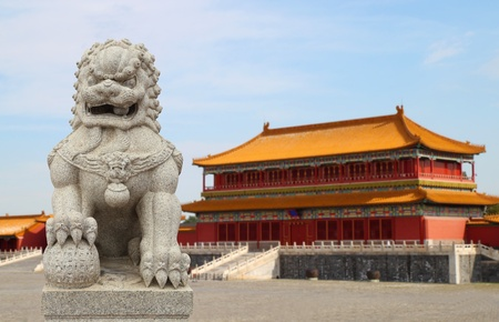 Chinese Imperial Lion Statue with Palace Forbidden city (Beijing, China) background