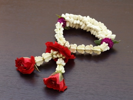 Garland of jasmine flower on wood background photo