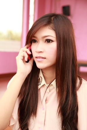young beauty woman  talking on the cellphone photo
