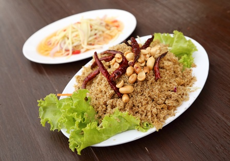 Crispy catfish salad with green mango on dish photo