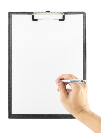 hand with pen writing on clipboard on white background photo