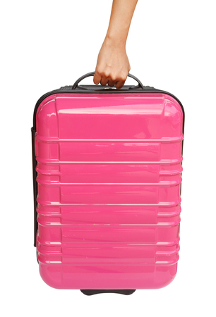 suitcase and hand isolated on white background  photo
