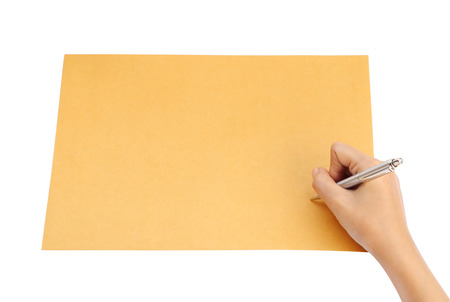 hand with pen writing on the envelope on white background  photo