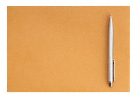 pen on the envelope on white background  photo