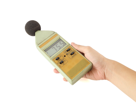 old sound level meter holding on hand photo