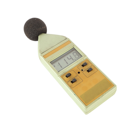 old sound level meter (display show high level) on white background photo