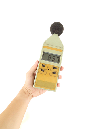 sound level meter holding on hand (on white background) photo