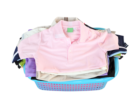 pile of clothes in basket on white background  photo