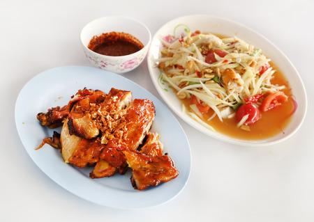 roasting chicken and spicy papaya salad (Thai style food) photo