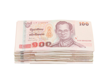 stack of Thai one hundred type banknotes on white background  photo
