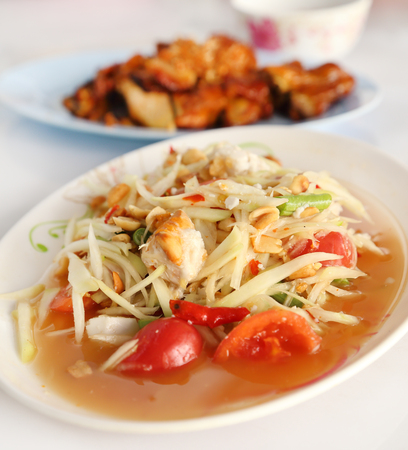 spicy papaya salad and roasting chicken (Thai style food) photo