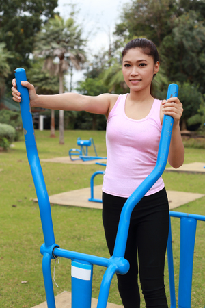 woman exercising with exercise equipment in the public park photo