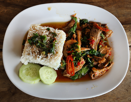 A fresh dish of Thai style food, Fried pork with sweet basil and white jasmine sticky rice photo
