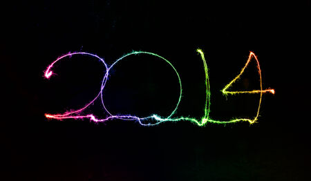 colorful happy new year 2014 written in sparkling letters photo