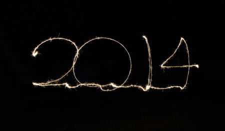 happy new year 2014 written in sparkling letters photo