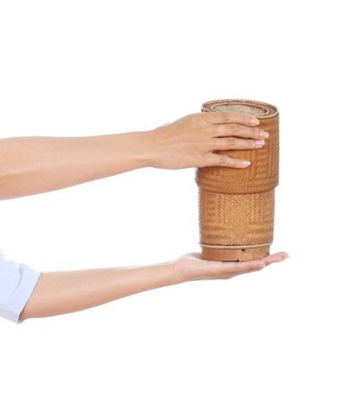 hand holding bamboo rice box isolated on white background photo
