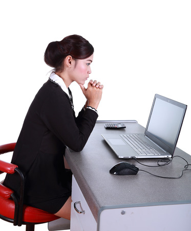 Business woman with a laptop - isolated on white background photo