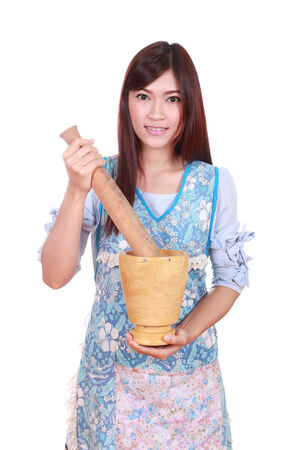 female chef with mortar and pestle isolated on white background photo