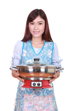 housewife with suki pot isolated on white background photo