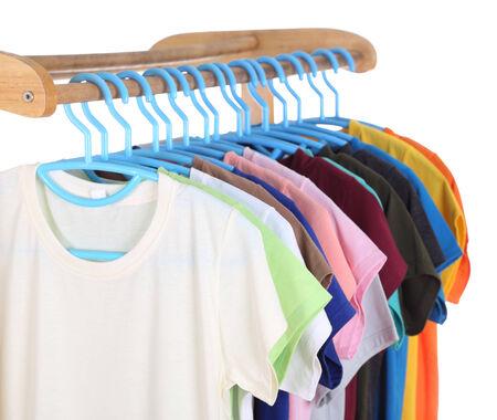 t-shirts hanging on hangers isolated on white background photo