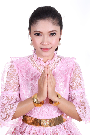 woman wearing typical thai dress pay respect isolated on white background, identity culture of thailand photo