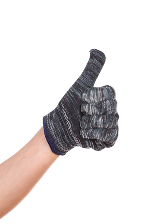 thumb up hand in glove isolated on white background photo