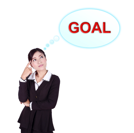 Business woman thinking about goal isolated on white background photo