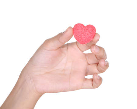 hands holding heart candy isolated on white background photo