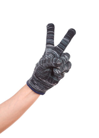 hand in glove with victory gesture isolated on white background photo