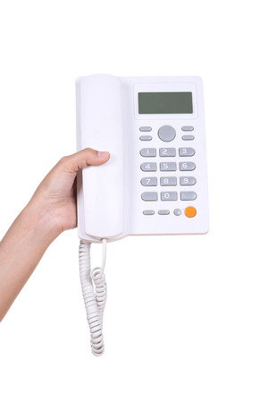 Hand holding white telephone isolated on white background photo