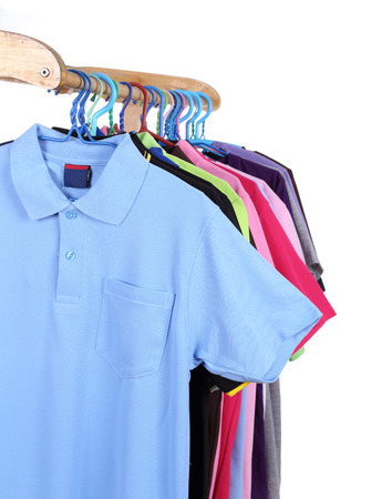 Hanging Polo shirt isolted on white background photo