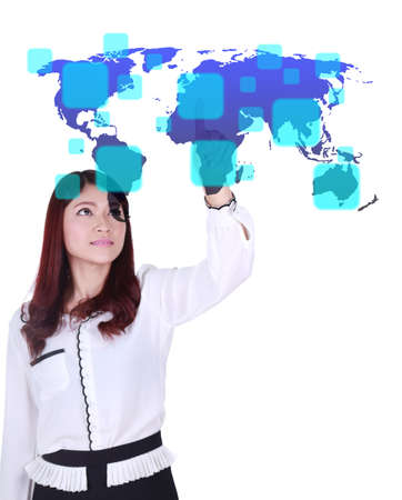 business woman pushing a button on a world map touch screen interface (choose Europe) photo