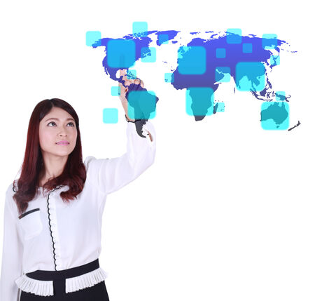 business woman pushing a button on a world map touch screen interface (choose America) photo