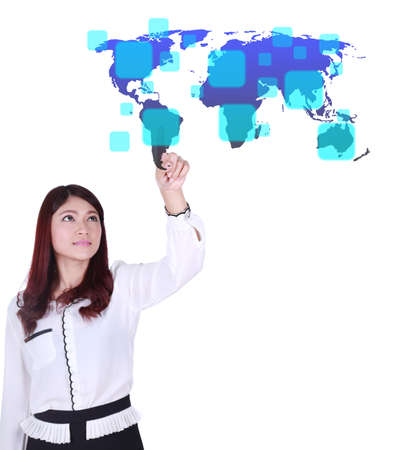 business woman pushing a button on a world map touch screen interface (choose South America) photo